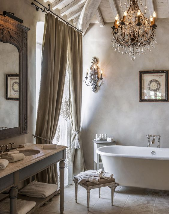 off-white and grey tones for a peaceful bathroom, and a wooden ceiling and draperies add a textural look