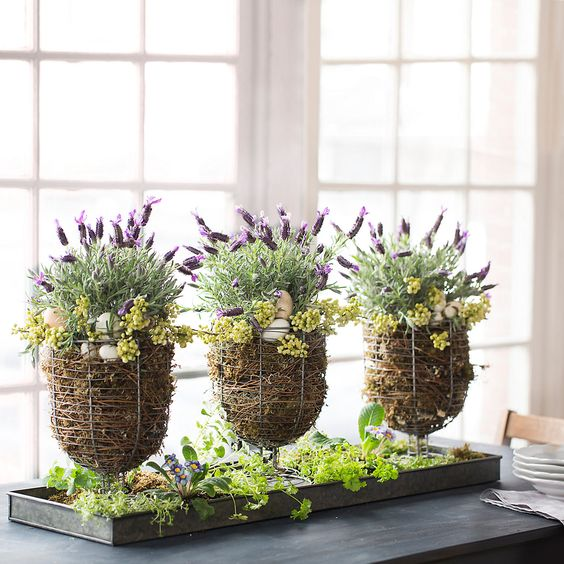 wire urn baskets with eggs and spring flowers