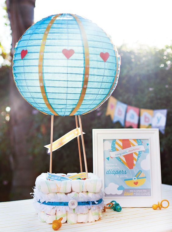 diapers with a blue paper lantern centerpiece for a boy's baby shower