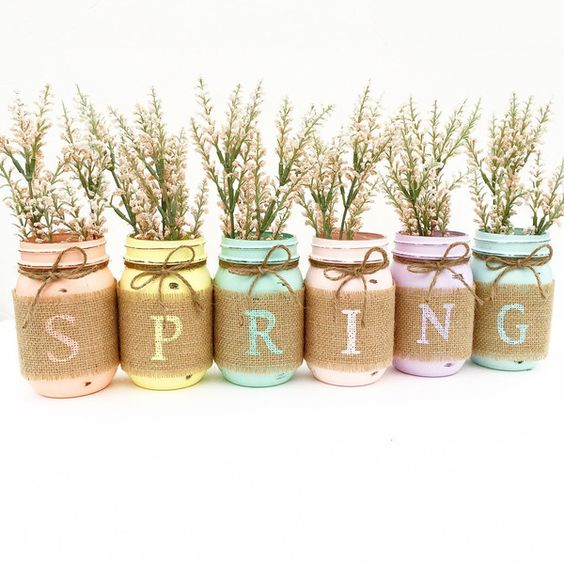 pastel-painted mason jars with burlap and twine, fresh bloom