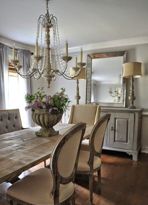 a stone planter, crystals on the chandelier and a rough wooden table look cool