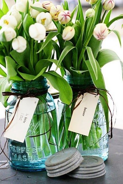 mason jars with twine and fresh tulips