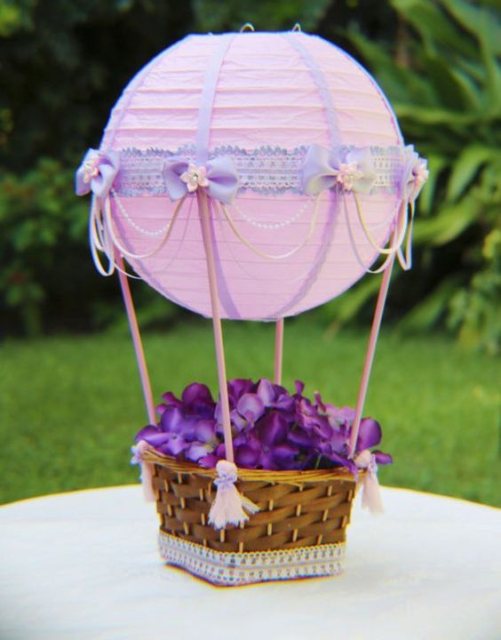 purple lanterns turned into hot air balloons with flowers in baskets
