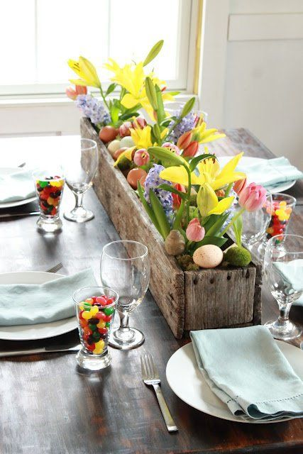 a rustic wooden box with colorful tulips and faux eggs