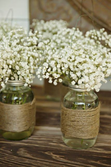 mason jars wrapped with twine and with baby's breath is a cute rustic idea