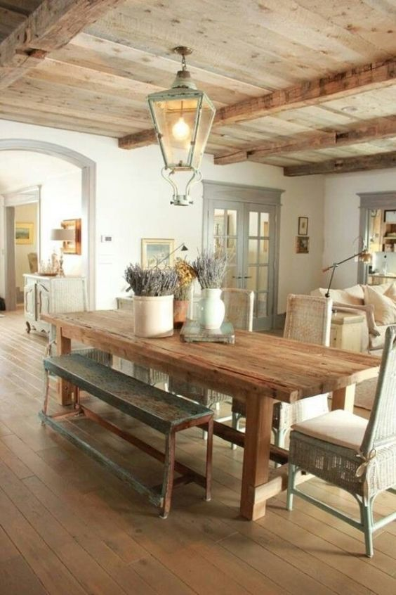 rough wooden ceilings, beams and furniture define this space