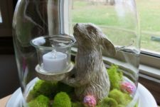 09 a cloche with moss and sequin eggs, a bunny candle holder