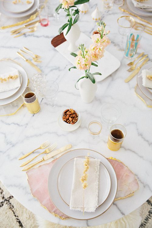 a modern tablescape on marble and with pink agate slices instead of placemats