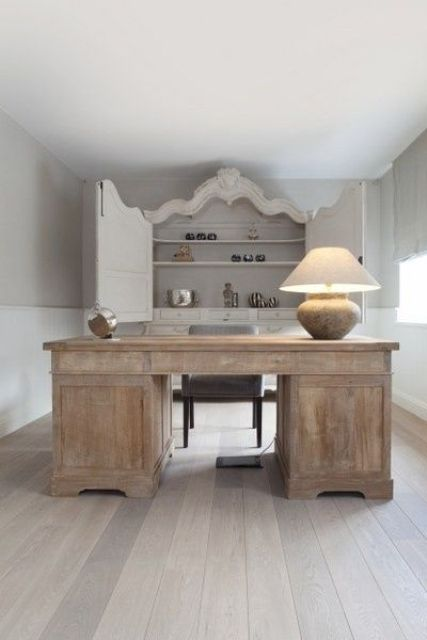 a rustic shabby wooden desk adds a textural feel to the office, too