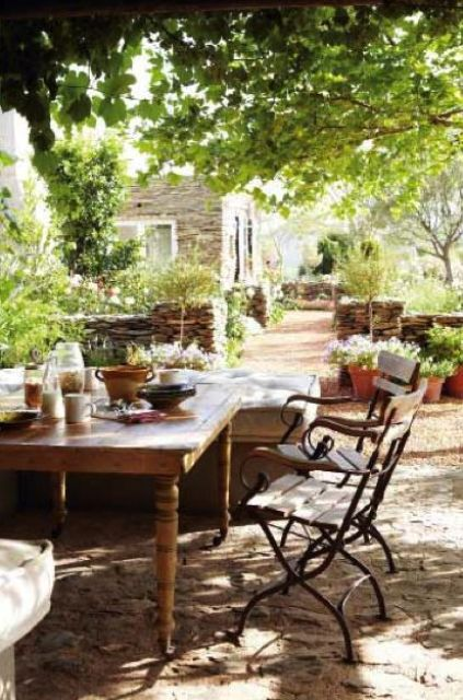 A Rustic Vintage Table And Antique Forged Chairs Will Be Perfect Solution For French