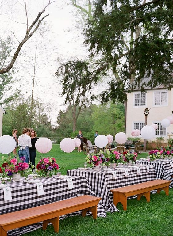 low hanging paper lantern garland to add cheer to the centerpieces and light up the tables