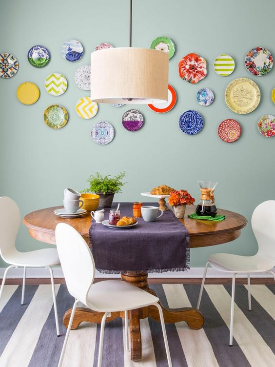 vibrant mismatching plates in the dining zone