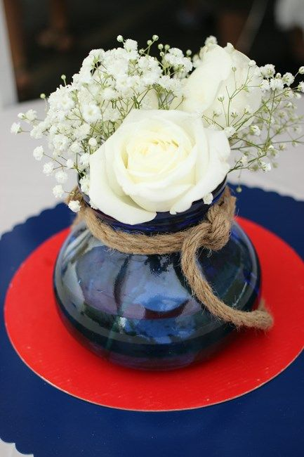 a navy porcelain vase with rope is ideal for a nautical bridal shower