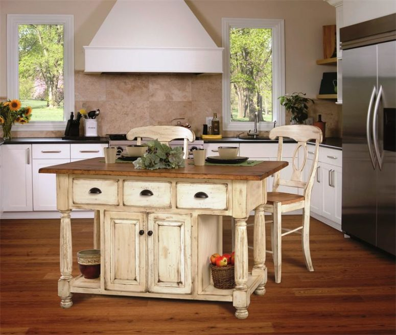 a shabby chic neutral kitchen island with a rustic wooden countertop