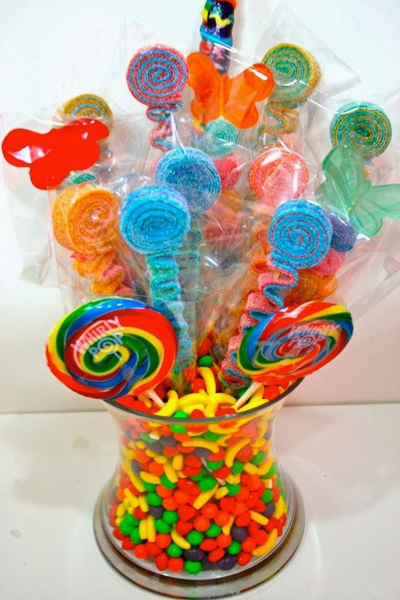 colorful sprinkles, candies and pops centerpiece