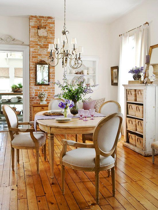 elegant upholstered dining set and a vintage chandelier that adds to the look