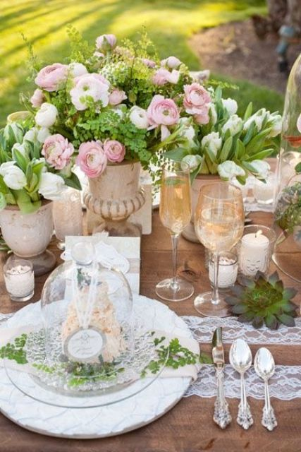 pink ranunculus, white tulips and lots of greenery make this vintage-inspired table fresher