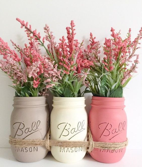 tied up mason jars in soft shades with simple flowers