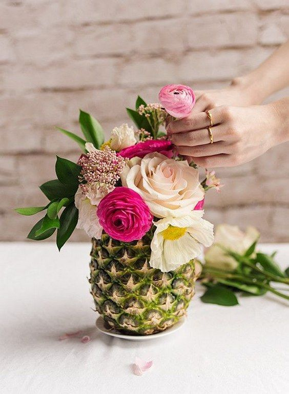 a pineapple as a vase for a tropical bridal shower