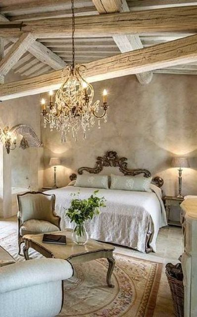 a stunning chandelier, a refined vintage bed and furniture set makes the room super exquisite