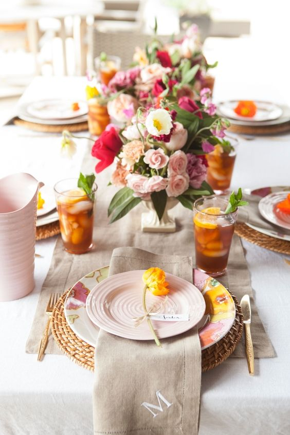 blush and colorful blooms give a color to this table and make it more interesting
