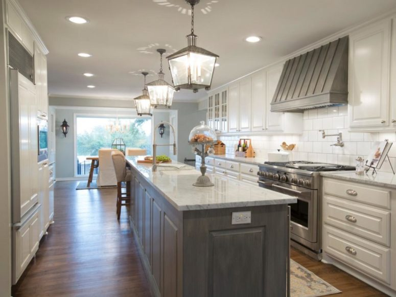 white cabinets with a shabby grey kitchen island and a hood for an accent