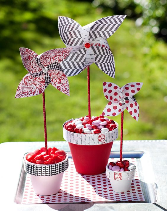 decoupage pots with candies and paper pinwheels