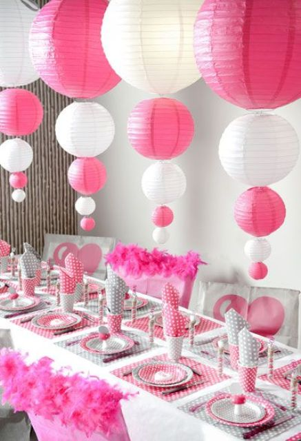 pink and white paper balloon vertical garlands over the table