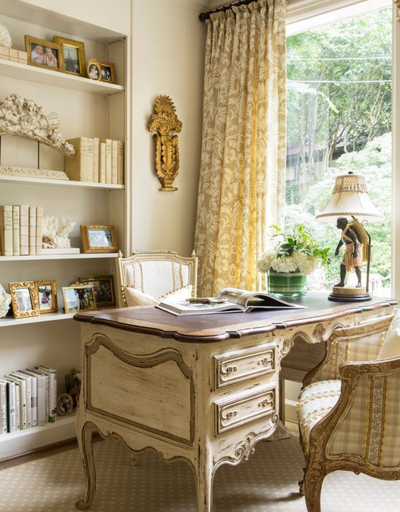 the furniture may be shabby and upholstered with checked fabric for a cozy feel