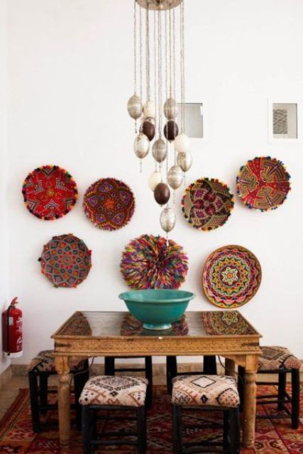 an African-inspired dining space with bold wall baskets and matching upholstery