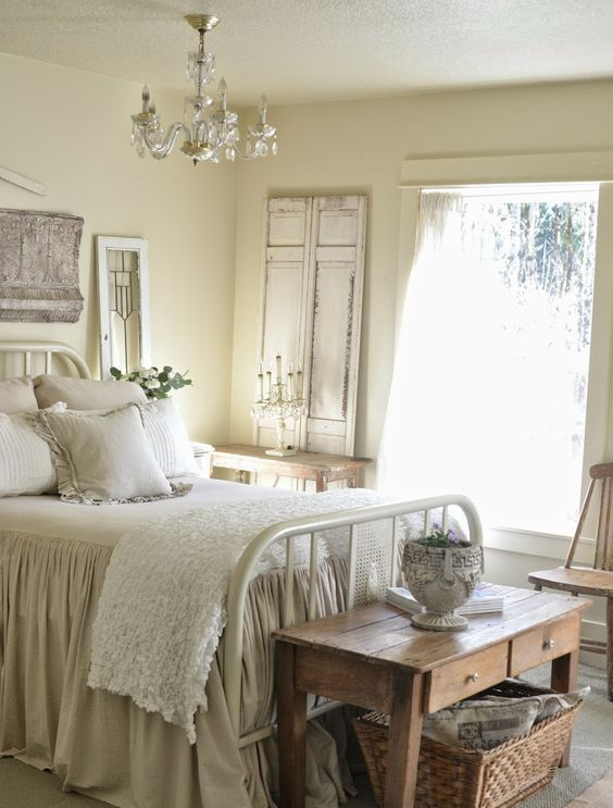 an old metal bed, a wooden coffee table, a basket for storage make this room rustic and cozy