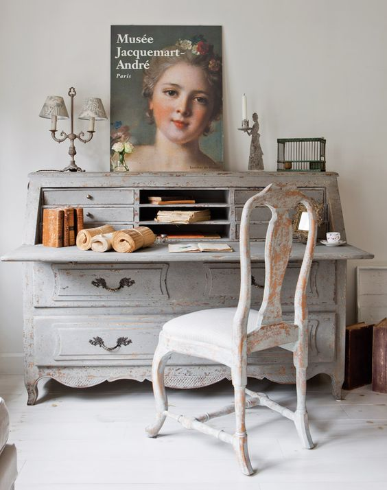unique vintage bureau used as a desk and a shabby patina chair