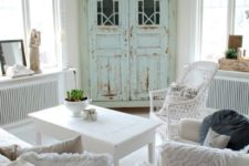 14 a mint-colored shabby chic armoire is a statement piece in this white space