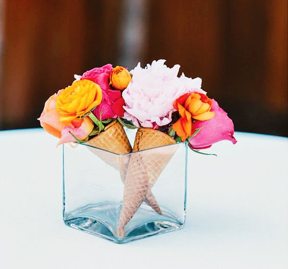 a vase with real ice cream cones and blooms inside
