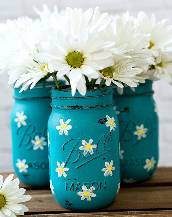 blue mason jars with painted camellias and with fresh blooms, too