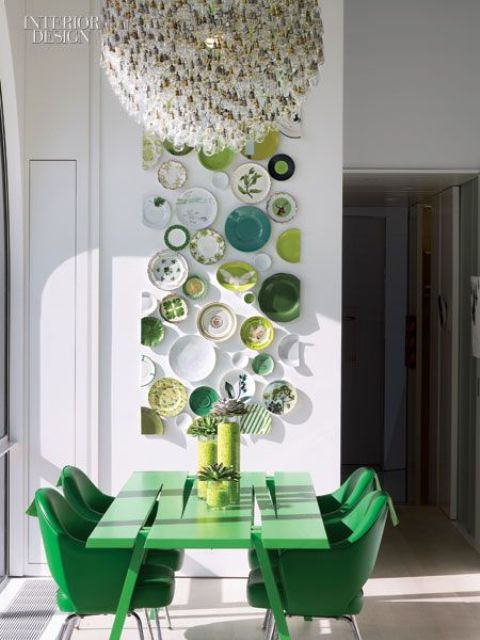 the plates are trimmed to make a perfect edge, and green shades echo with the dining set