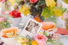 14 this table setting is infused with very bold flowers, which create a friendly ambience