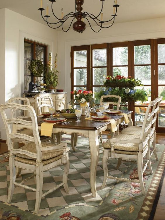 whitewashed table and chairs with a stained tabletop