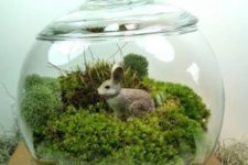 15 a jar with moss and a faux bunny is a simple to realize idea