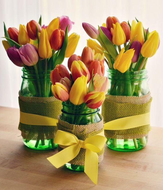 green mason jars with burlap and yellow bows, colorful tulips