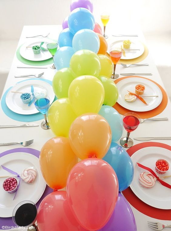 a large balloon garland on the whole table length