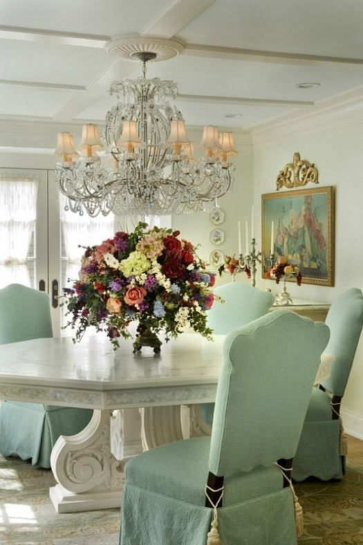 a refined white table and chairs with mint covers for a colorful touch