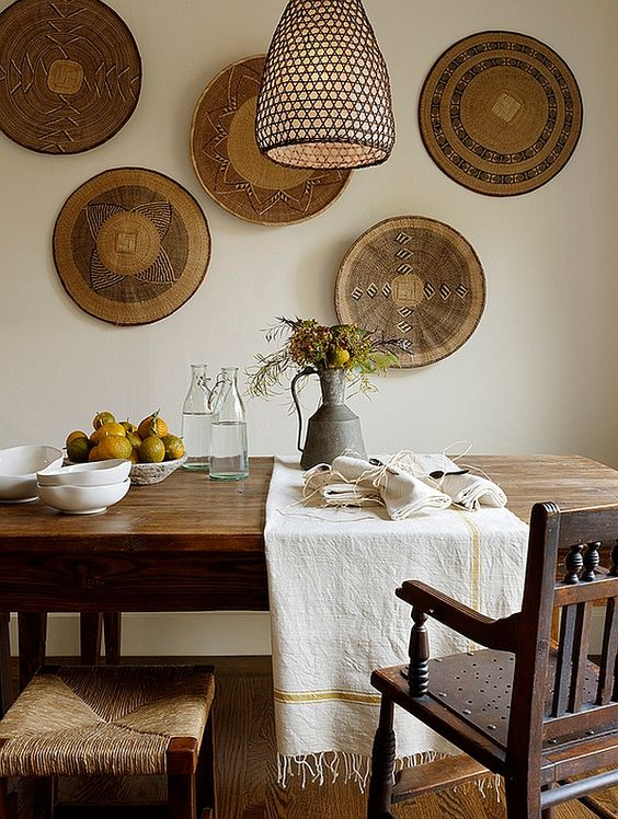 a rustic African feel is give to this warm dining space with baskets