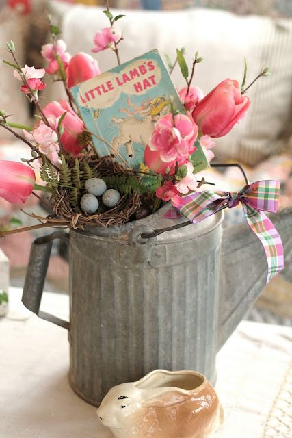 a shabby watering can with pink tulips, a faux nest and a vintage card