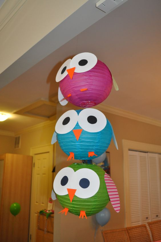 bold paper lanterns turned into owls will do for any baby shower