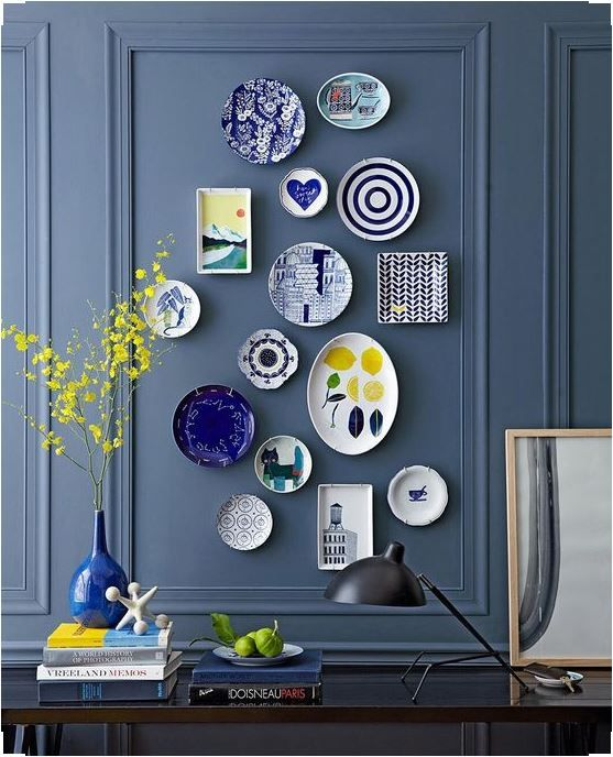 colorful plates arrangement on a dark blue wall