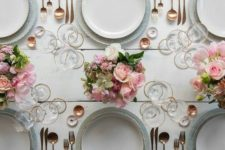 16 the tablescape is neutral but with pink centerpieces and glam gold cutlery