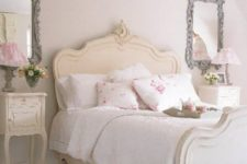16 vintage framed mirrors, bedside tables and a cream colored bed give a tone to the whole space