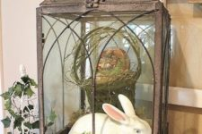 17 a large vintage lantern with a basket and a dyed egg and a white bunny