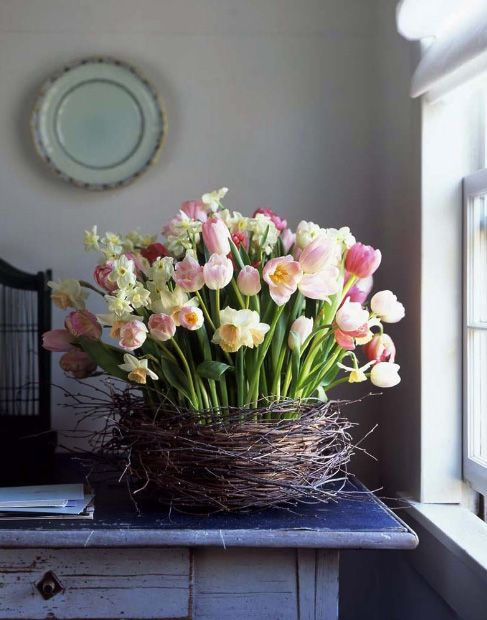a spring bloom arrangement covered with twigs